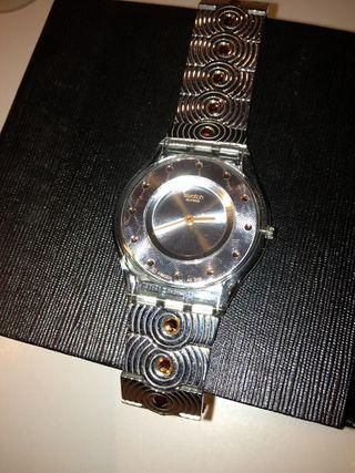 Reloj swatch plano