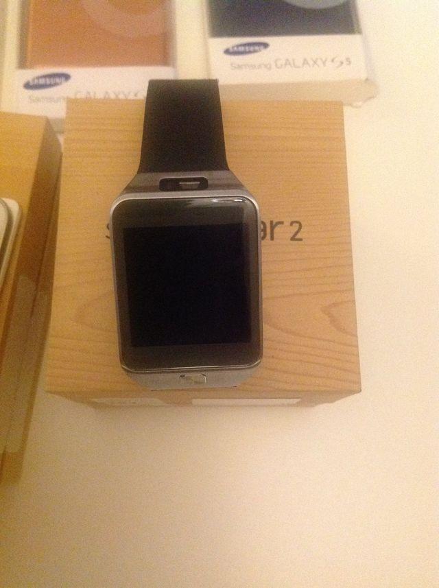 Samsung Galaxy S5+ Samsung Gear 2 Smart Watch.