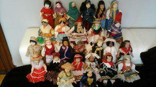 26 bonitas muñecas de porcelana de países.