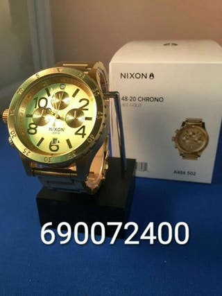 Reloj nixon 48-20 gold (garantia)