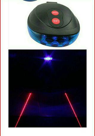 Luz led - laser de seguridad para bicicleta.