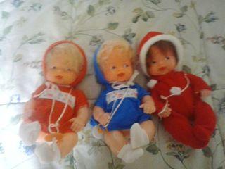 Tres muñecos antiguos nuevos