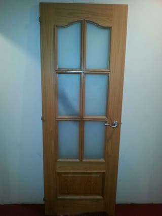 puerta maciza acristala