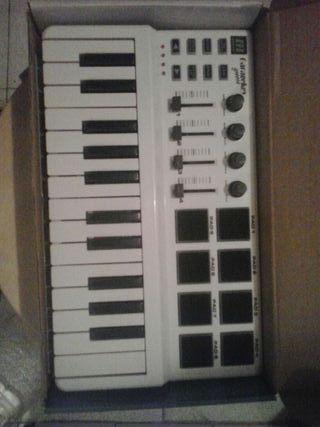 Piano midi y controladora hércules