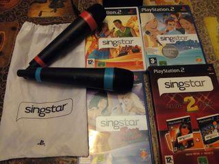 5 juegos de sing star+ 2 microfonos inalambricos.