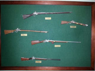 Armas en miniatura de metal