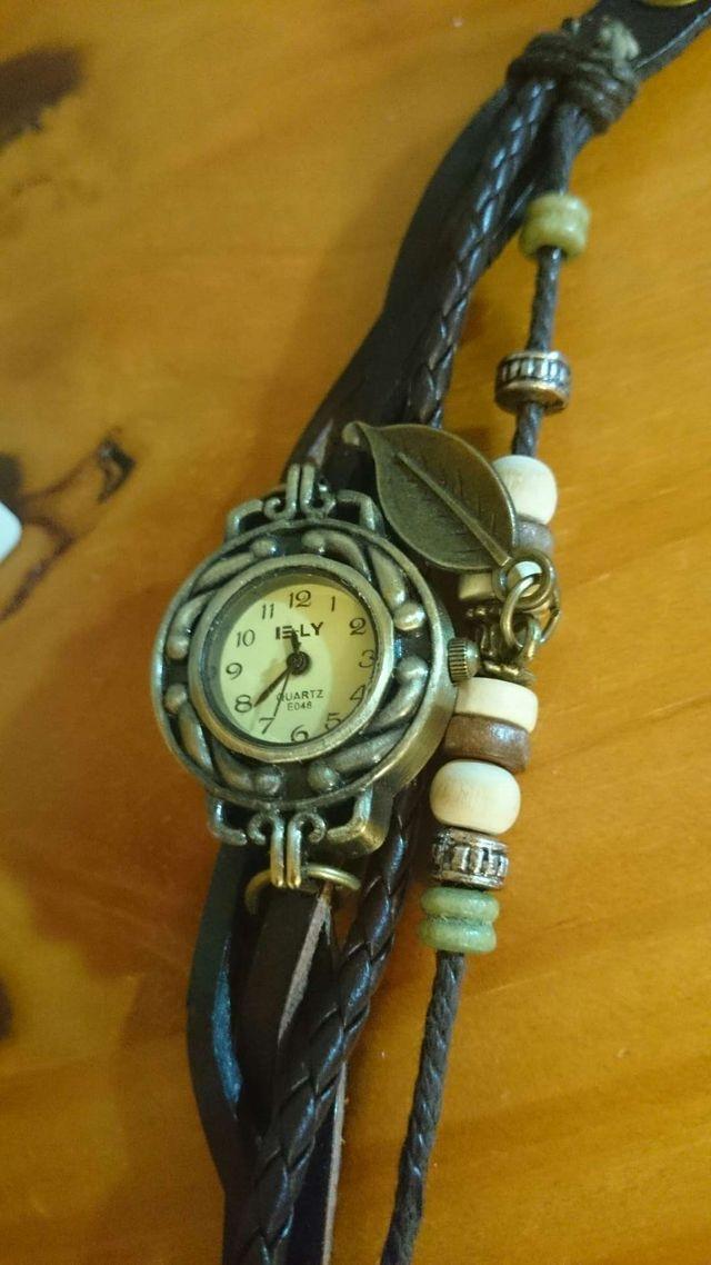 Reloj étnico