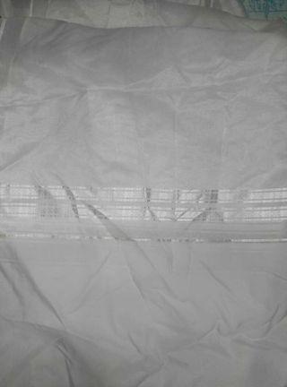 Cuatro visillos de cortina