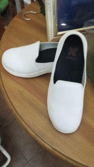Zapatos blancos de seguridad