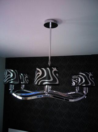 Se vende lampara de 6 focos en negro y plata