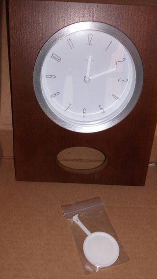Reloj de pared péndulo