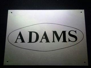 Cartel adams