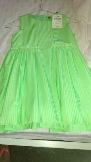 Vestido tizzas con la etiqueta verde precioso