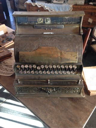 Caja registradora antigua de bronce