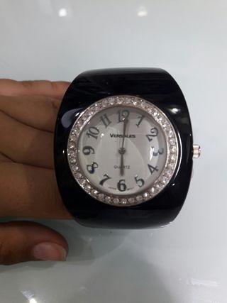 Reloj versales