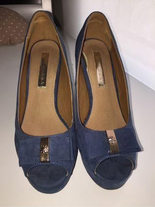 Zapatos nuevos apenas usados
