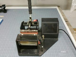 Prensa para imprimir en tazas de ceramica.