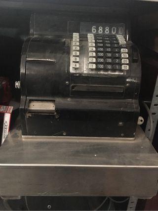 Caja registradora antigua. Huguin .