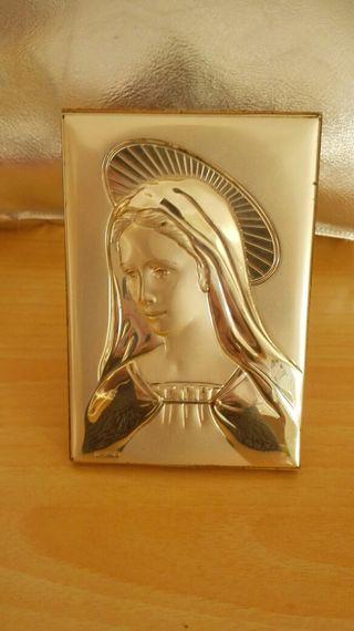 Virgen de plata en bajo relieve
