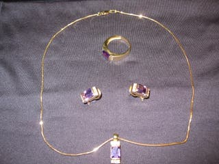 Conjunto de oro 18 kilates 18 gramos
