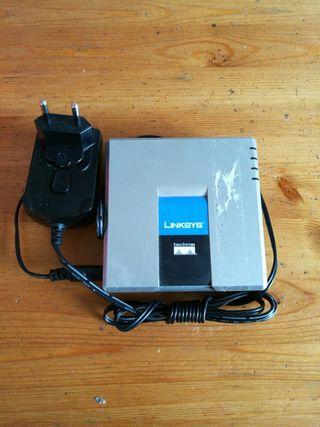 Adaptador de teléfono analógico Usado