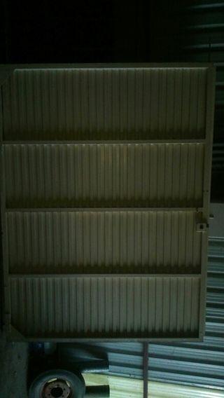 Puerta de garaje de 2 alas