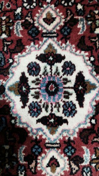 Pequeña alfombra persa.