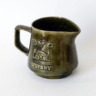 Antigua jarra de cerámica, publicidad DYC