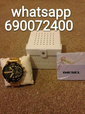reloj diesel dorado y negro