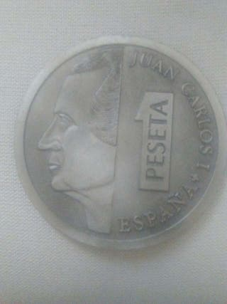 Pisapapeles moneda 1 peseta