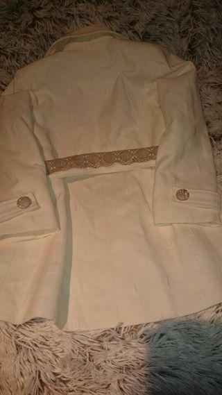 Conjunto de abrigo y minifalda sin estrenar