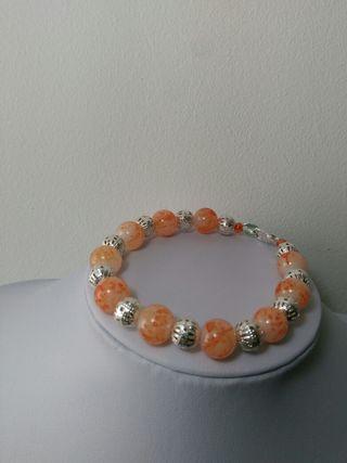 Pulsera de cristal naranja estampado