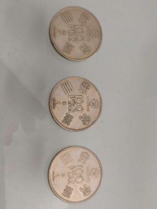 Monedas de 100 pesetas.
