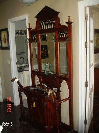 mueble de entrada en madera y bronce