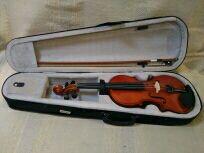 violin 4 /4 nuevo con arco, funda y resina.