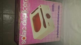 máquina de depilación con cera caliente