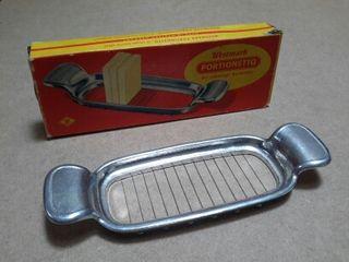 Antiguo cortador mantequilla y queso.