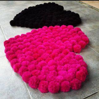 alfombras de pompones.