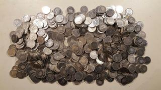 300 monedas de una peseta