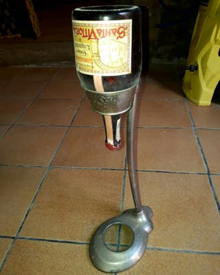 Soporte antiguo botella