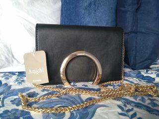 Bolso/ cluch Amichi. Negro con detalles dorados