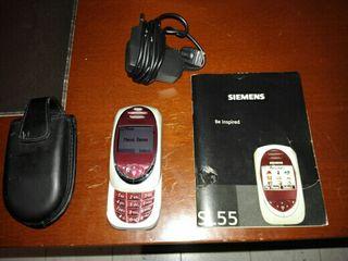 Teléfono Siemens con su bolsito su cargador