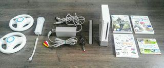 Consola Wii + juegos + mandos + volantes.