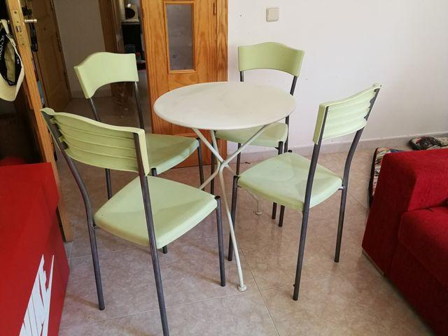 Conjunto mesa y sillas de terraza
