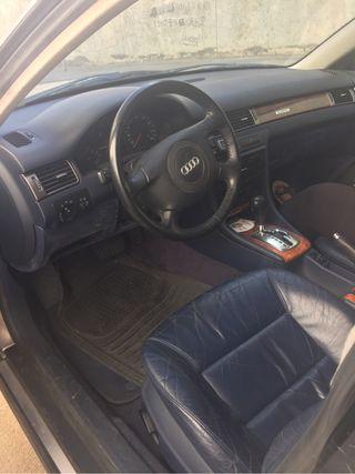 Audi A6 beige sillones cuero marino