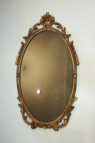 Espejo antiguo con marco de bronce