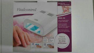 Secador de uñas ultravioleta.