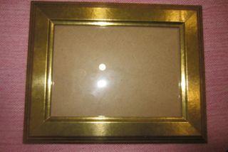 Portafotos dorado 25 x 20 cm.