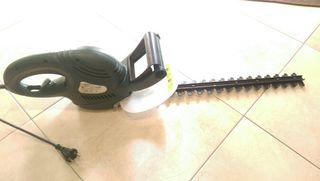 máquina de cortar setos