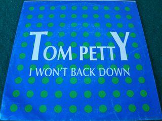"TOM PETTY.-I WAN'T BACK DOWN- SINGLE VINILO 7""."